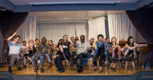 All participating 26 musical saw players playing together. Photo Harris Graber